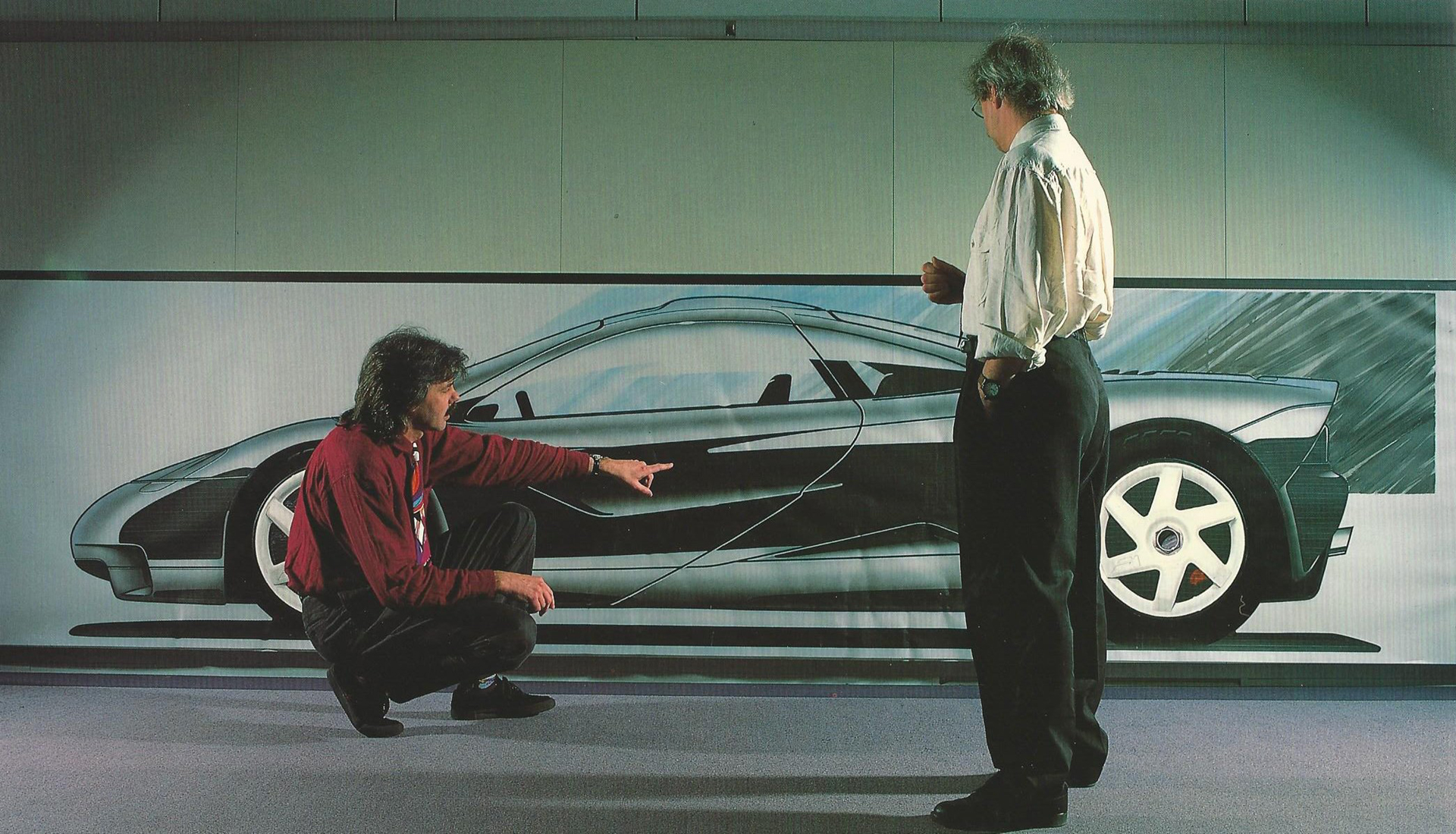 Gordon Murray explains to Peter Stevens the F1's Dihedral Door access to its one-plus-two seating.